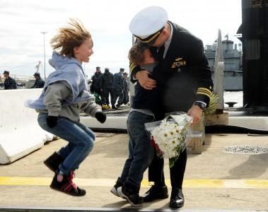 USS Norfolk returns home.